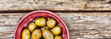 Olives on a wooden background. View from above