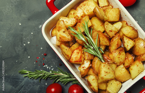Baked potatoes with spices and rosemary, top view - 182520064