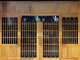 Wooden door and front wall, Japanese or Chinese restaurant, space for the name of the restaurant or text and logo on the top.