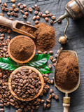 Roasted coffee beans  and ground coffee on wooden table. Top view. - 182525868