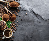 Roasted coffee beans  and ground coffee on wooden table. Top view. - 182525897