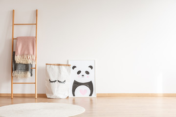 Kid's room with panda drawing