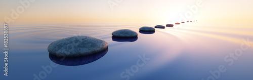 Fotobehang Zen Steine im See bei Sonnenaufgang Querformat 3:1