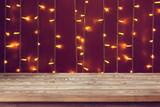 Empty wooden worktop on the Christmas lights. - 182536066