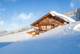 Wooden mountain chalet lodge in the alps in winter - 182536888