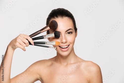 Beauty portrait of a cheerful beautiful half naked woman