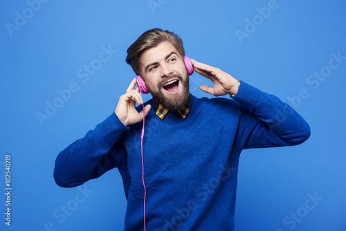 Fotobehang Muziek Man listen to music by headphones and singing