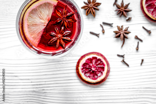 Plakat mulled wine with spices in cup wooden background top view