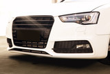 Sport gloss white car, close the look of the front of the vehicle. Sunny weather