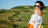 View of a girl in dress in Tuscany hills, Italy - 182546650