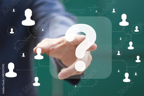 Businessman presses button question icon