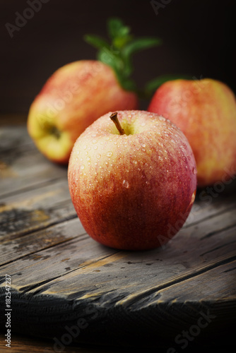Red sweet apple and the woodan background, selective focus