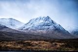 A snowy mountain in Glencoe, Scottish Highland, during a rain storm