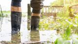 Men wear black boots for a flood. - 182563617