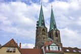 The steeples of the parish church of St. Nikolai's in Quedlinburg, Saxony-Anhalt, Germany. - 182567296