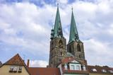 The steeples of the parish church of St. Nikolai's in Quedlinburg, Saxony-Anhalt, Germany. - 182567296