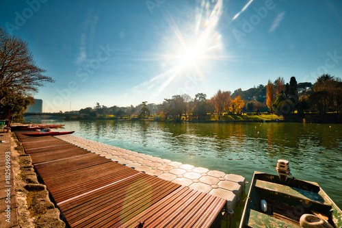 Foto op Canvas Rome moored boat in city lake