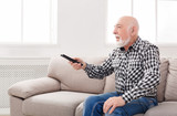 Calm senior man watching tv copy space - 182575405