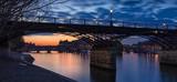 Sunrise on the Seine River with Pont des Arts and Pont Neuf. Ile de la Cite, 1st Arrondissement, Paris, France