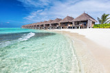 Water villas in a row by the seashore on Maldives Tropical resort - 182578632