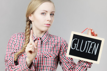 Woman holding board with gluten sign