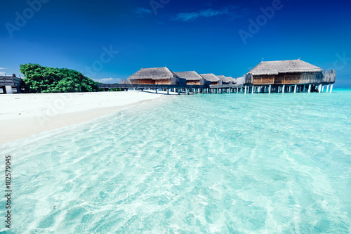 Foto op Canvas Tropical strand Summer hotel with houses standing in the water on Maldives