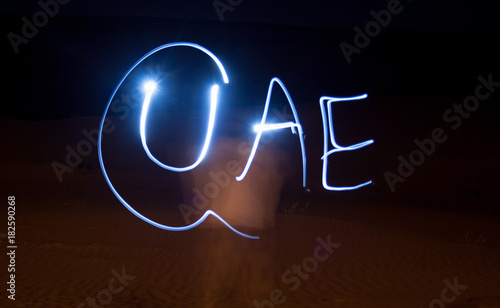 Foto op Canvas Abu Dhabi UAE word painting with light
