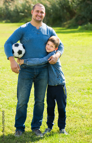 Plexiglas Voetbal Man and little boy spending time with ball
