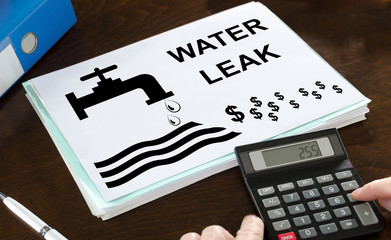 Water leak concept illustrated on a paper