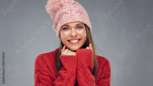 Close up face portrait of toothy smiling young woman wearing red sweater