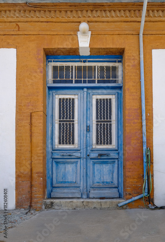 Poster Cyprus Old blue wooden doors in Cyprian village.