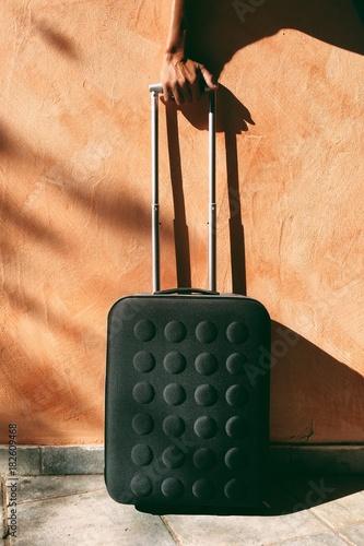 suitcase on the orange wall