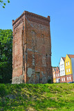Gateway tower of the former episcopal lock of the 14th century. Braniewo, Poland - 182609671