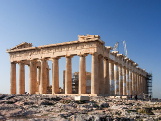 Early morning light and blue skies illuminate the Parthenon a top the Acropolis in Athens, Greece.