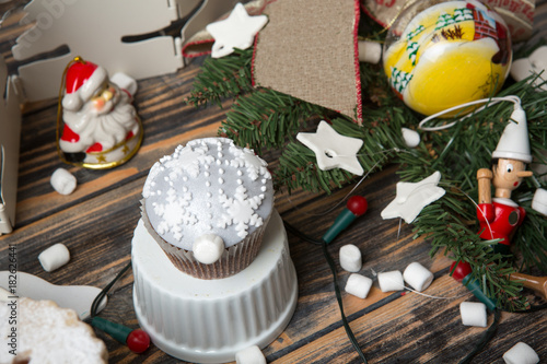 Sticker Cupcakes on christmas decorated wooden table