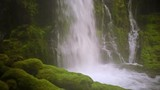 Aerial shot of amazing an amazing waterfall and moss covered rocks in Oregon. - 182634494