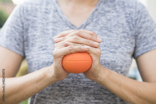 hand of woman holding stress ball