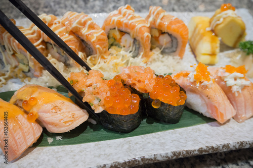 Staande foto Sushi bar Sushi sashimi and sushi rolls set