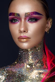 Beautiful girl with creative glitter makeup with sparkles, unusual eyebrows. Beauty is an art face. Photo taken in the studio. - 182667239