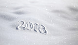 New year 2018 celebration message handwritten on the sunny shiny fresh snow. Selective focus used. - 182671239