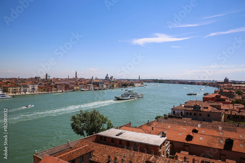 Fotobehang Landschappen Landscape view of Adriatic Sea with boats and historic buildings in Venice, Italy, Europe.