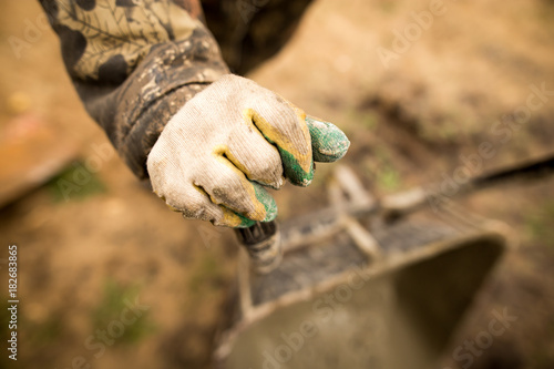 hand of a worker at a construction site
