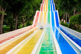Large Multi-road Colorful Waterslide in Tropical Park - 182684018