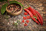 Pepper, chili and spices on old wooden background. - 182684852