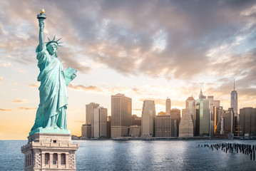 The Statue of Liberty with Lower Manhattan background in the evening at sunset, Landmarks of New York City, USA