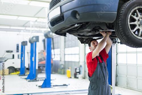 Sticker Car mechanic working at automotive service center