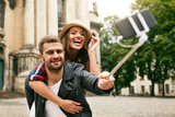 Lovely Tourist Couple Taking Photos On Phone On Street - 182696477
