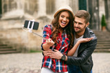 Lovely Tourist Couple Taking Photos On Phone On Street - 182696634