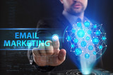 The concept of business, technology, the Internet and the network. A young entrepreneur working on a virtual screen of the future and sees the inscription: Email marketing - 182704057