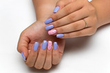 summer colored purple, pink manicure with white flowers and crystals on long square nails on a white background   - 182706420